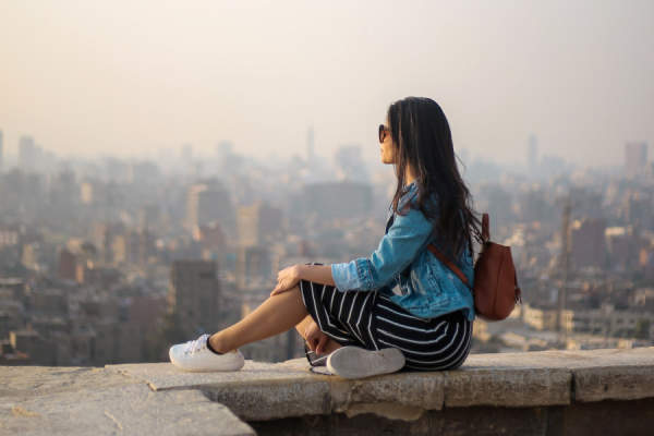 woman sitting looking at city skyline