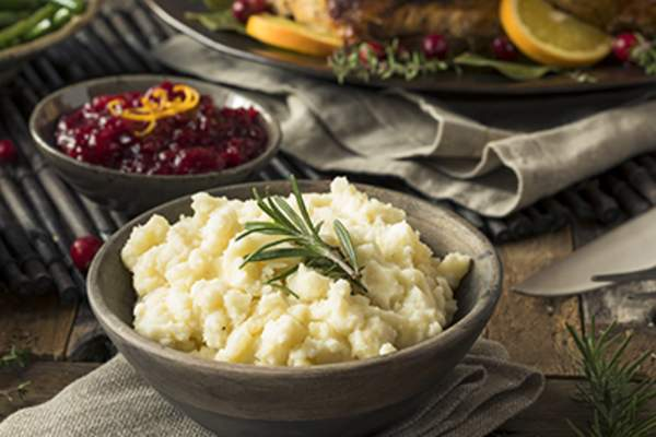 Mashed potatoes on a Thanksgiving table.