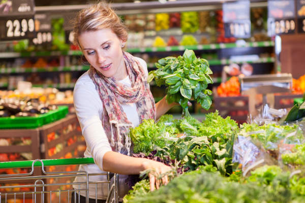 Picking out leafy greens at market