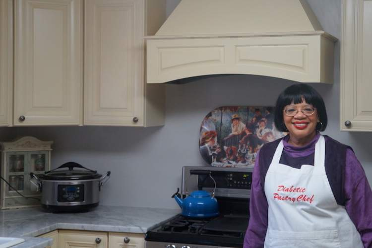 Stacey Harris at home in her kitchen.