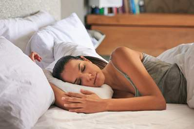 Woman sleeping on a comfortable bed.
