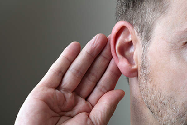 Man experiencing hearing loss caused by RA.