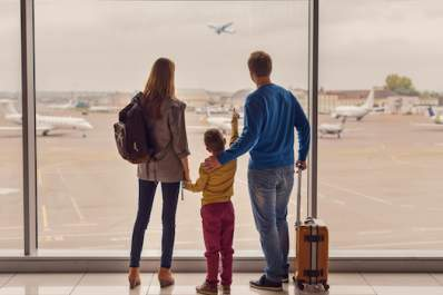 A family at the airport watching planes take off.