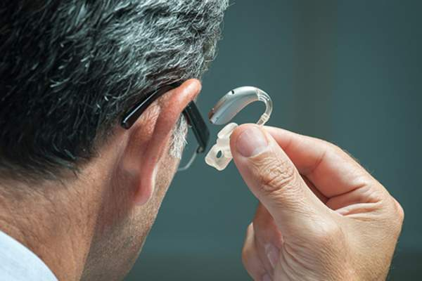 Man with hearing aid image.