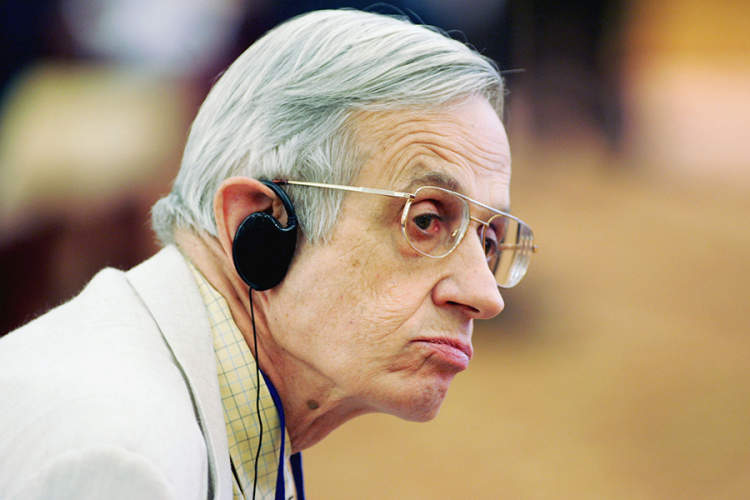 Nobel prize laureate John Forbes Nash of USA listens during a colloquium featuring entrepreneurship and corporate growth at the Nobel Laureates Beijing Forum 2005.