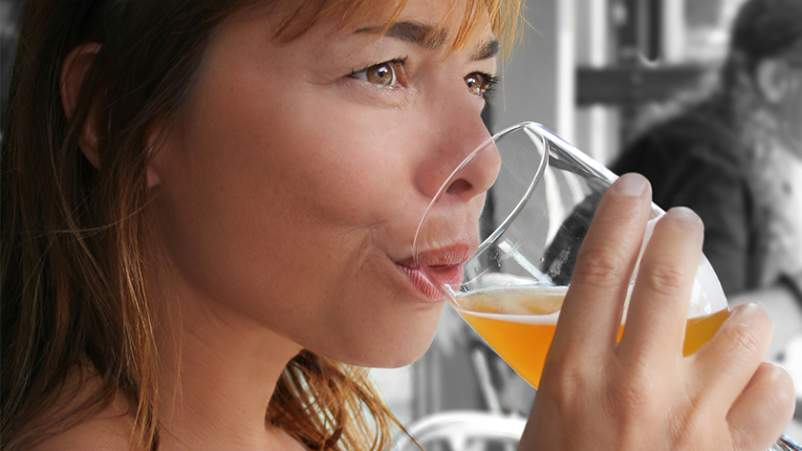 Woman drinking beer.