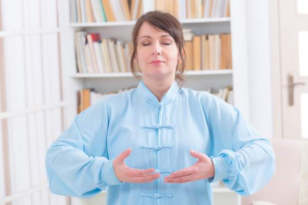 Woman practicing Qigong