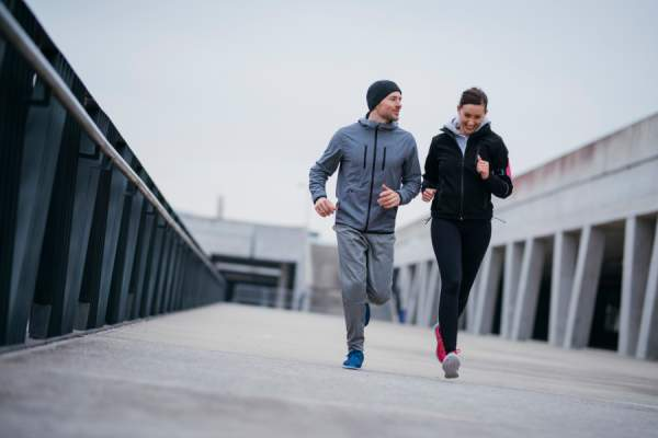 couple jogging together in winter