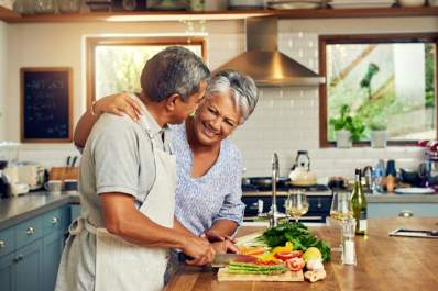 Happy couple preparing healthy meal.