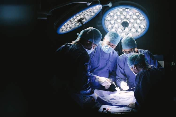 Group of surgeons in hospital operating theater.