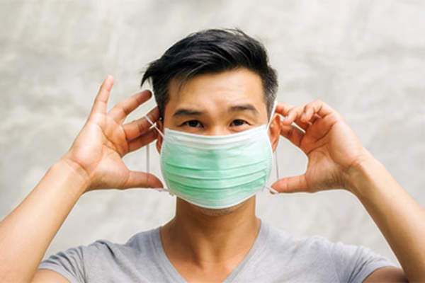 Man wearing hospital mask.