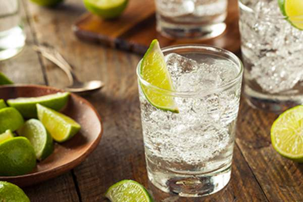 Drink with a slice of lime.