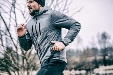 Young man jogging outside in cold weather.