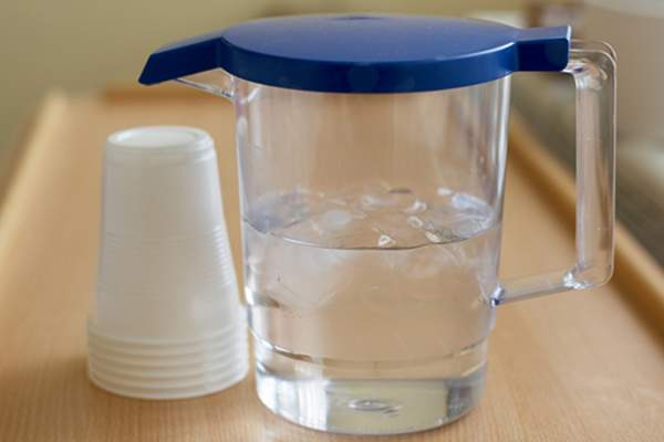 pitcher of ice water on hospital tray