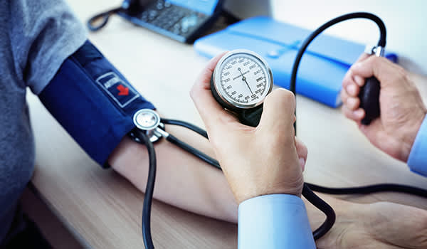 Doctor measuring a patient's blood pressure.