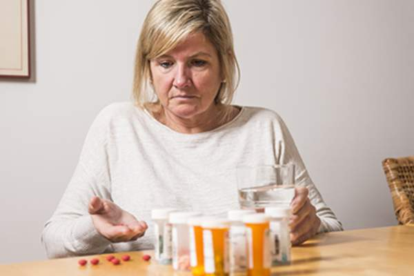 Woman with many medications.
