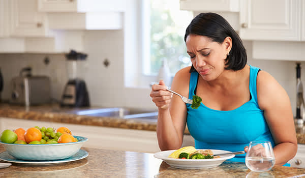 woman dieting eating alone image