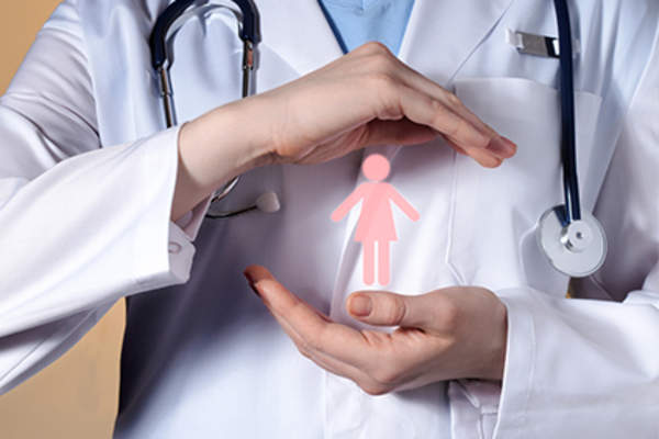 Doctor holding female image, provides care for women.