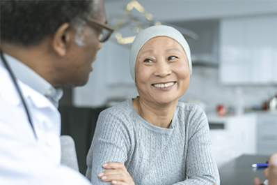 Woman smiling at her oncologist.