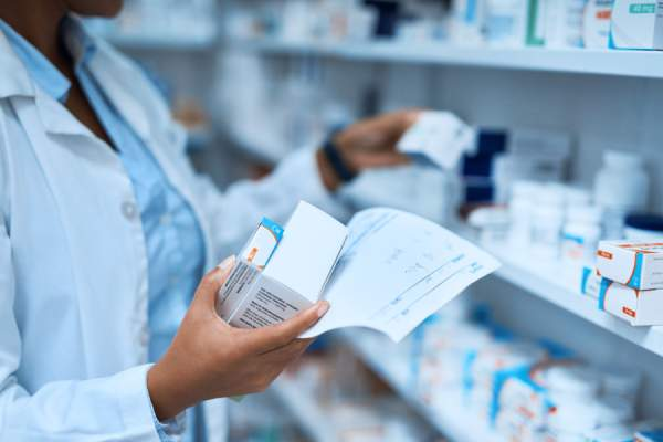 pharmacist getting prescription medications ready