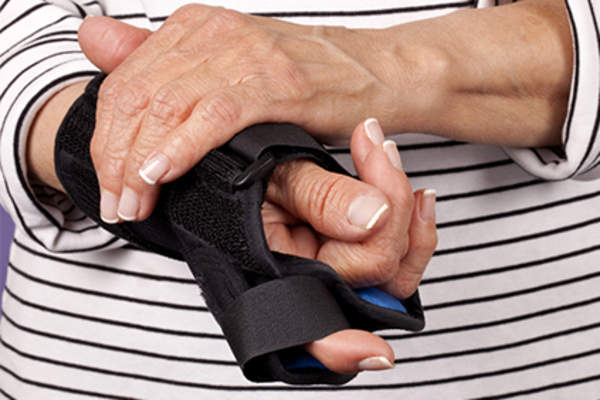 Woman with hand in resting splint.