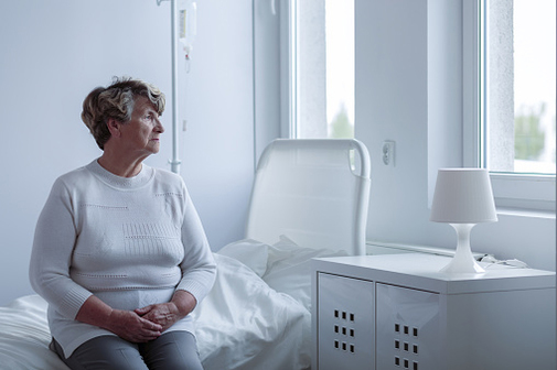 woman patient in hospital looking out window