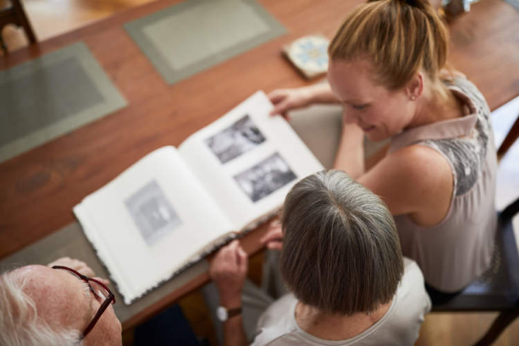adult family looking at photo album