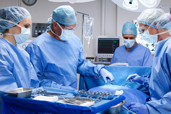 Surgical team performing operation.