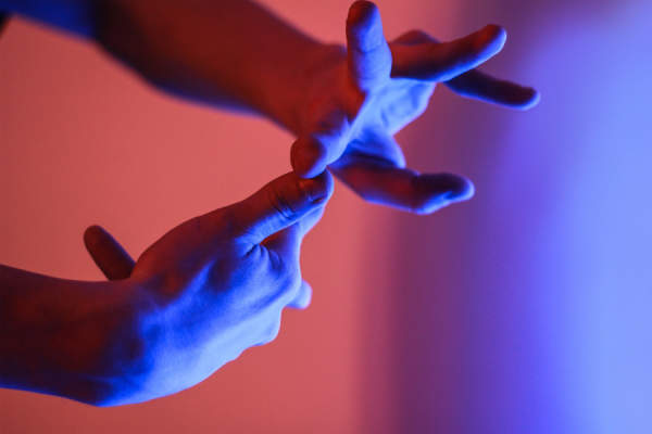 red and blue lights shining on fingers