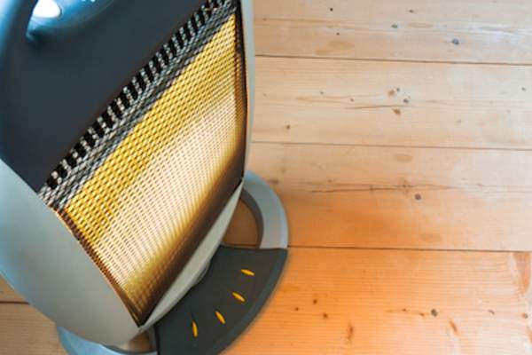 Space heater on pine floor.