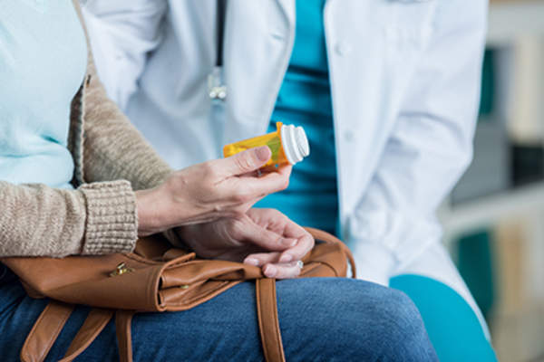 Woman with medication in her purse.