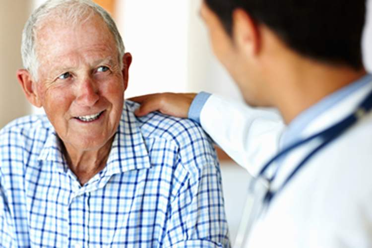 Doctor talking to senior patient.