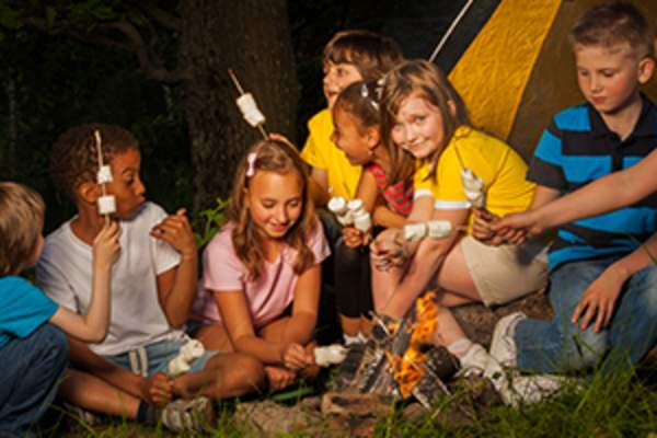 kids staying up late camping image