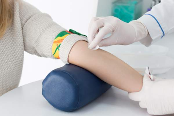 Woman being prepped for blood test