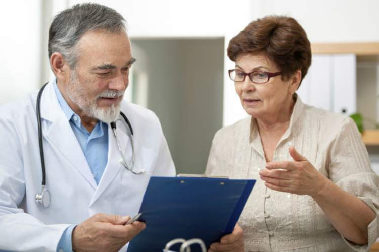 woman talking to doctor in white coat