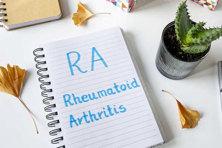 Rheumatoid arthritis notes in notebook.