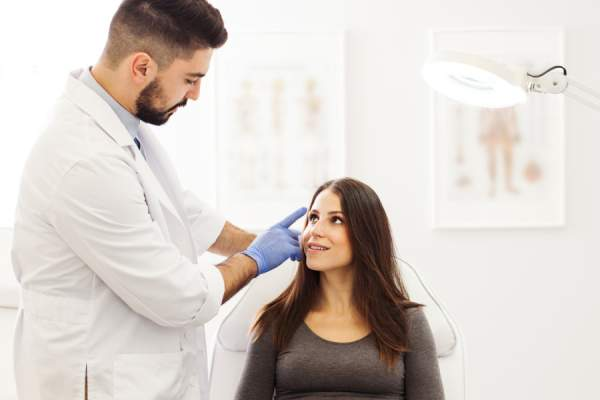woman talking to dermatologist