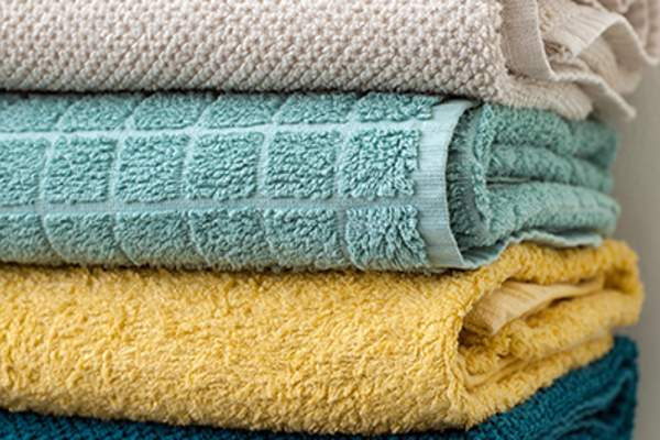 Stack of folded bath towels.