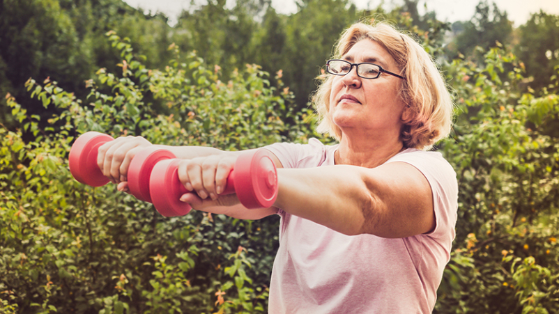 Middle age woman doing strength training exercises.