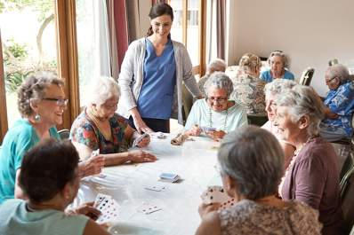 Seniors playing cards at a nursing home.