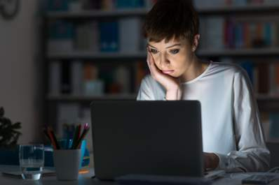 Woman on computer researching STIs and STDs