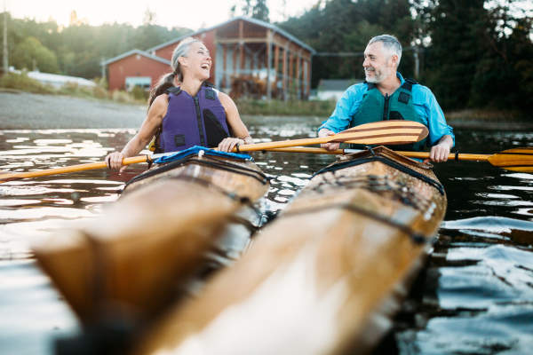 Mature couple kayaking.