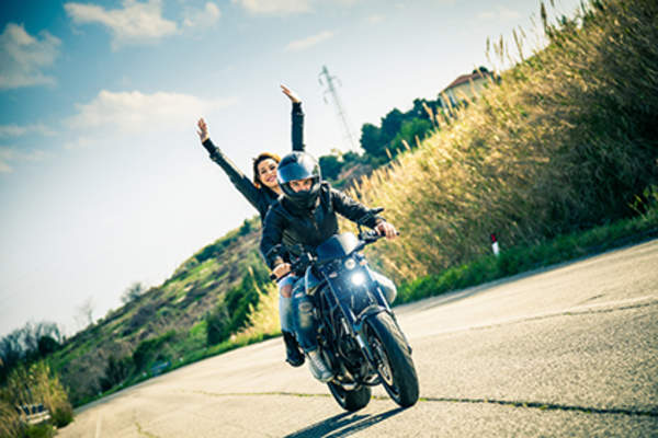 Couple on a motorcycle.