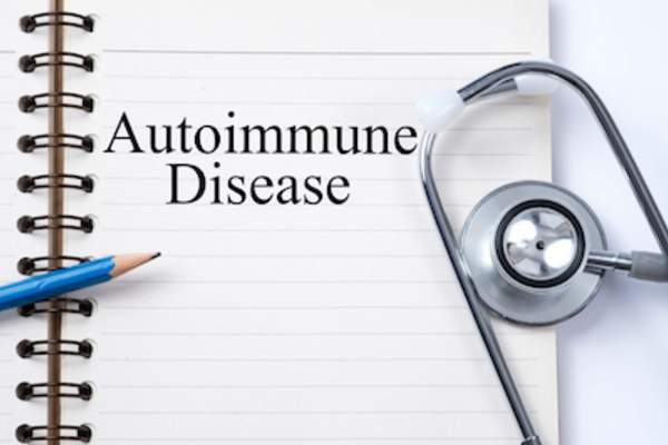 Autoimmune disease concept, stethoscope and notepad.