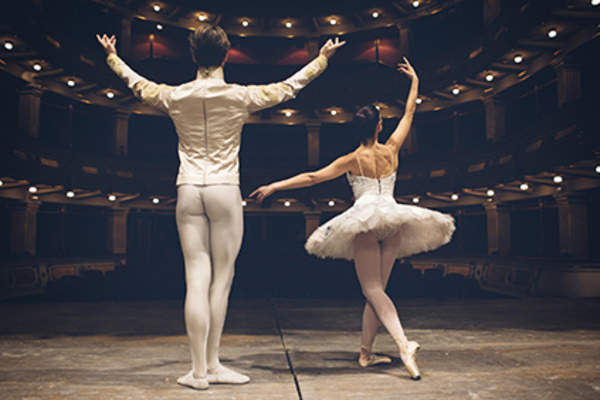 Ballet dancers on a stage.