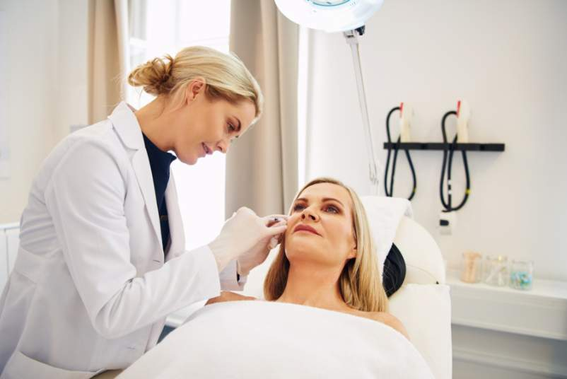 dermatologist with patient