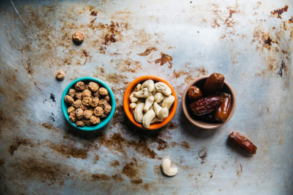 various nuts and fruits in small bowls