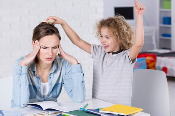 frustrated mother with ADHD child
