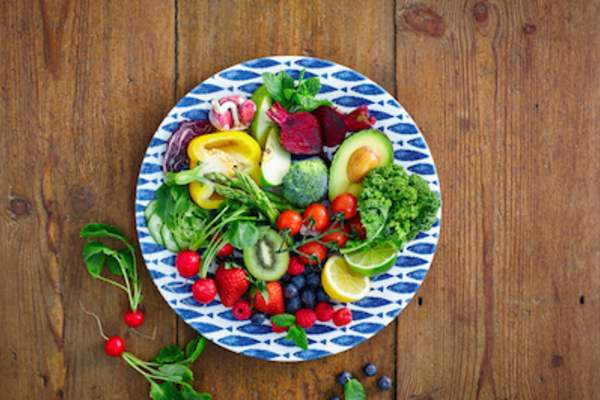 Fresh fruits and vegetables on plate.