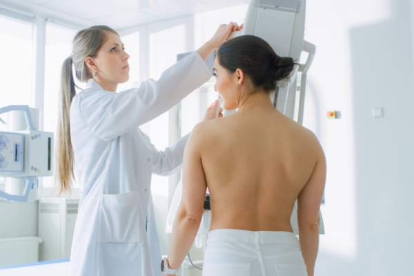 Young woman getting mammogram